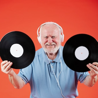 High angle senior with music records