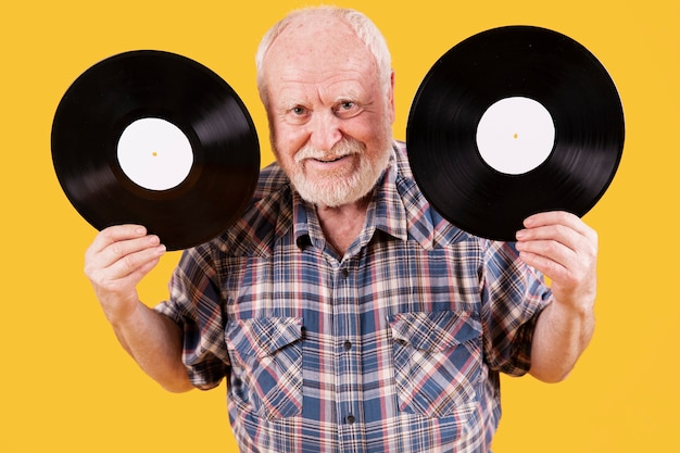 High angle senior with two record music
