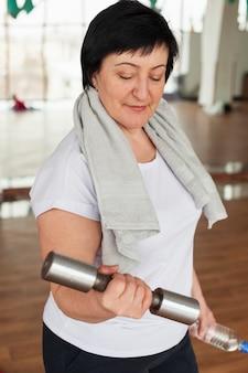 High angle senior woman at gym