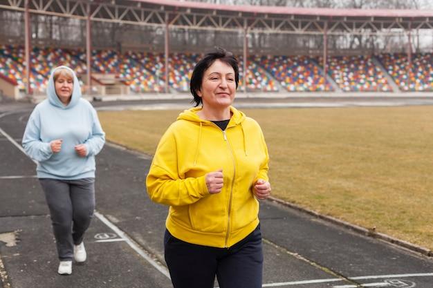 High angle senior women running