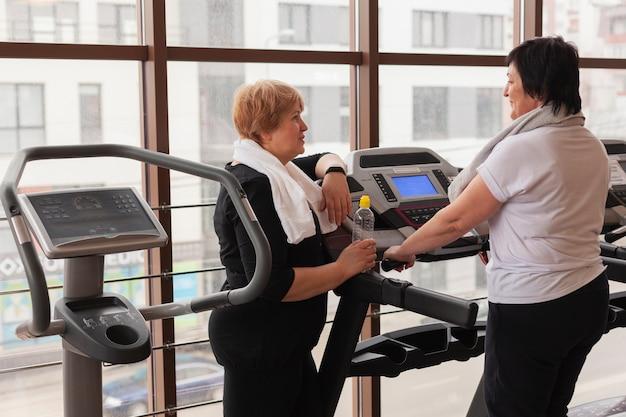High angle senior women working on treadmill