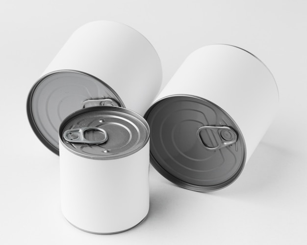 High angle of set of tin cans with blank labels