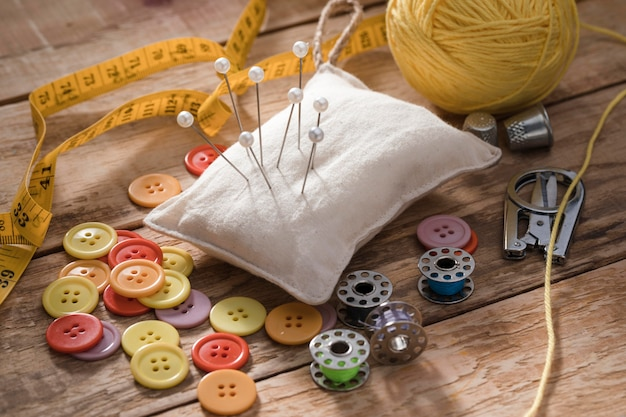 High angle of sewing needles with thread and buttons