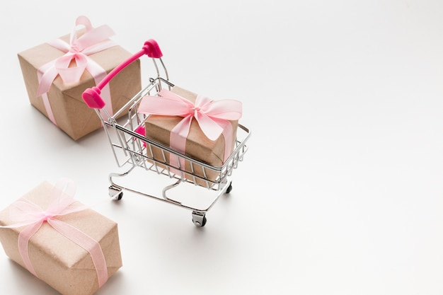 High angle of shopping cart with presents