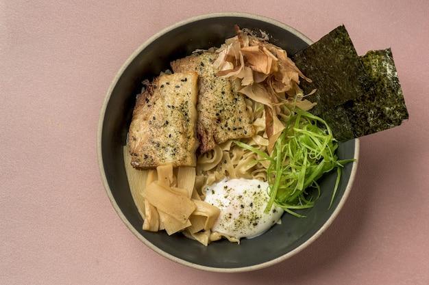 High angle shot of asian meal with salmon and seasonings