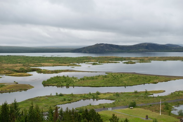 High angle shot of the beautiful landscape in thingvellir, iceland under the storm clouds