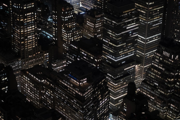 High angle shot of the beautiful lights on the buildings and skyscrapers captured at night