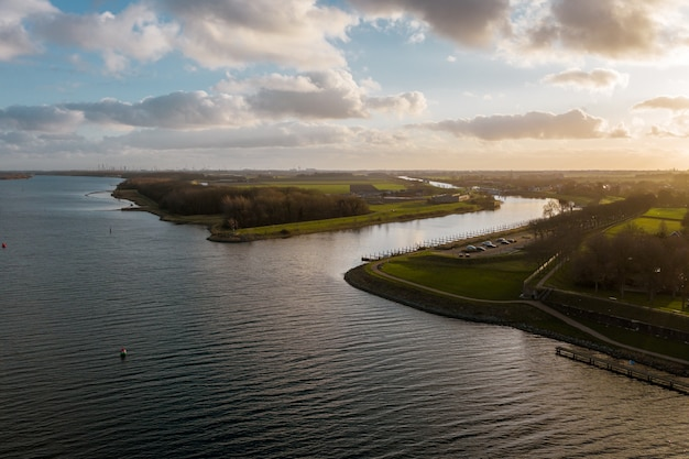 High angle shot of a beautiful river under a cloudy sky in veere, the neverlands