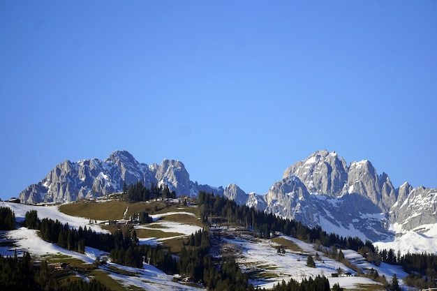 High angle shot of a beautiful snowy valley and the rocks under the sky in the