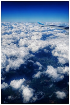 High angle shot of a beautiful view of sea clouds seen from the airplane