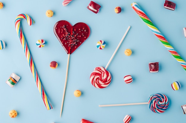 High angle shot of candy canes and lollipops