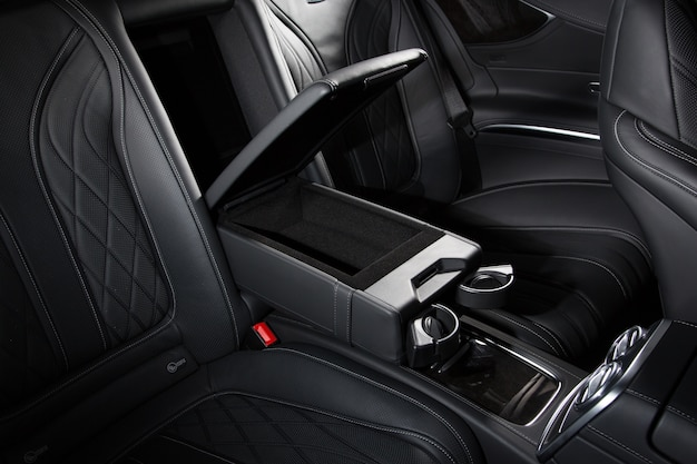 High angle shot of a car's black modern interior - perfect for