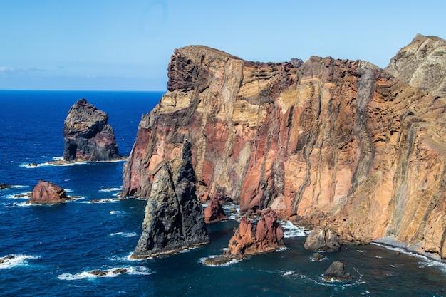 High angle shot of the cliffs on the ocean shore in ponta de sao lourenco, madeira