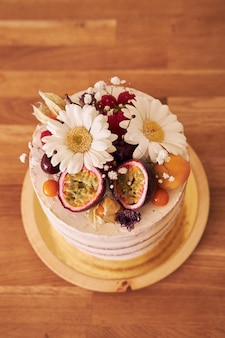 High angle shot of the delicious decorative cake on a brown table