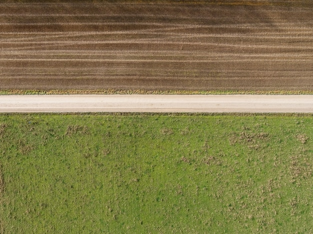 High angle shot of a field with partially gone dry because of changes in weather