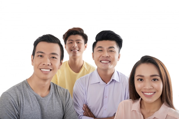 High-angle shot of happy asian people standing together and looking up