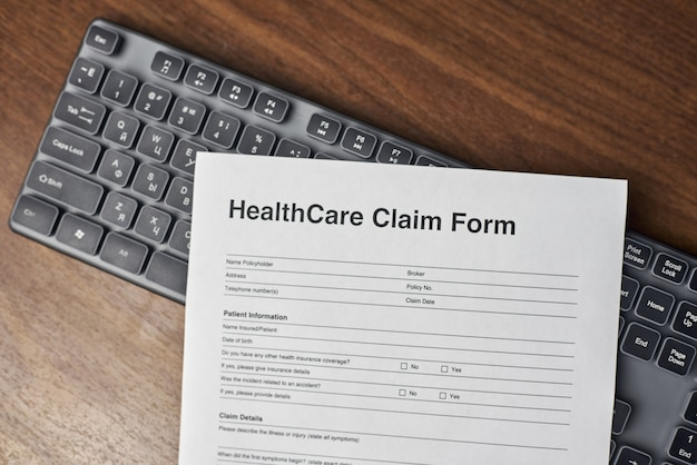 High angle shot of a healthcare claim form on a keyboard