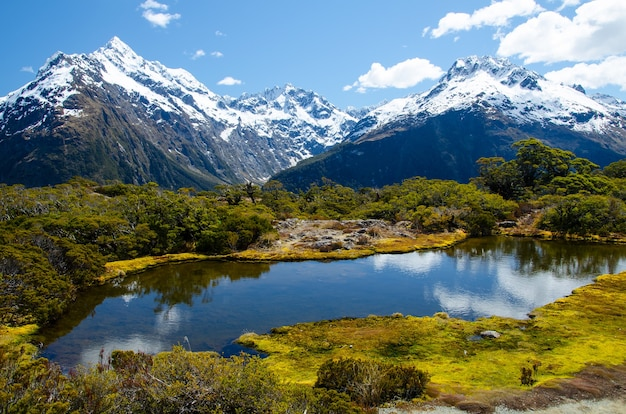 High angle shot of the key summit and the lake marian in new zealand
