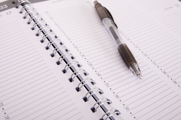 High angle shot of a pen on an open notebook