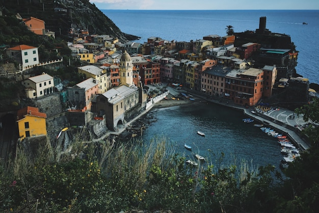 High angle shot of pond with boats near the building in vernazza