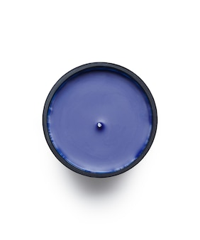 High angle shot of a purple scented candle under the lights isolated on a white background