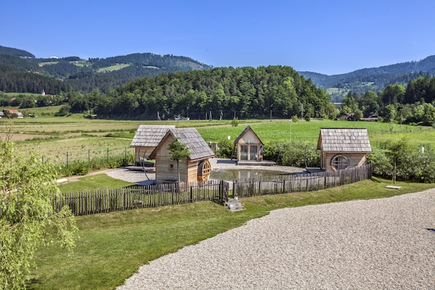 High angle shot of small wooden houses in the countryside in slovenia