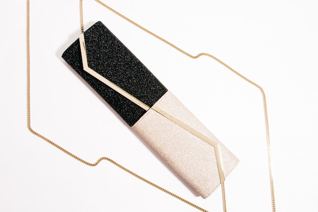 High angle shot of trendy luxurious evening clutches with golden chains