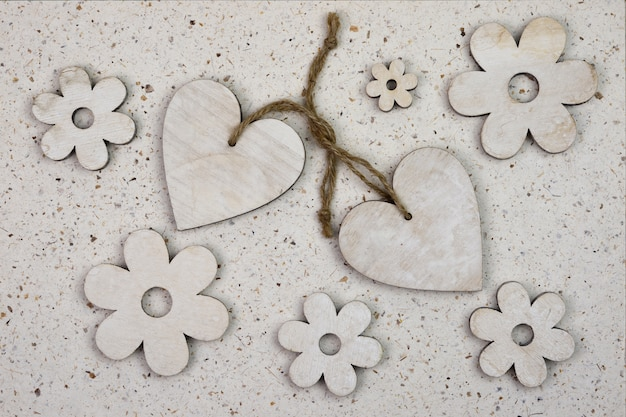 High angle shot of wooden heart-shaped ornaments with flowers