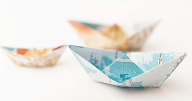 High angle small blurry paper boats