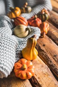High angle small pumpkins on wooden table