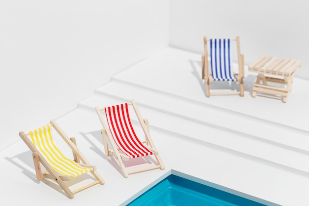 High angle small sunbeds next to small swimming pool