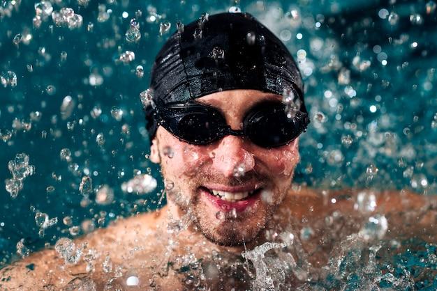 High angle smiley man swimming