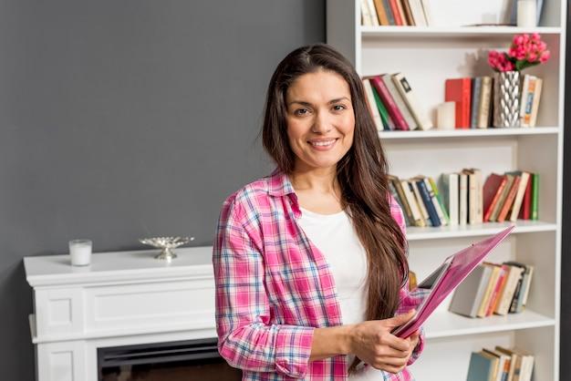 High angle smiley woman holding map