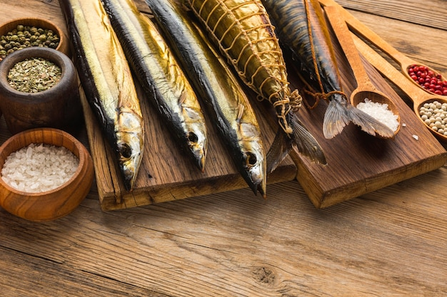 High angle smoked fishes on wooden table