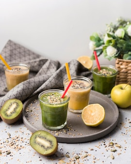 High angle smoothies with kiwi and apple