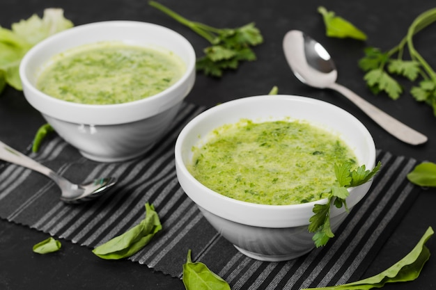 High angle of soup bowls with parsley