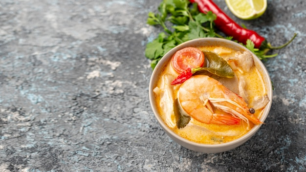 High angle soups in bowls with shrimp lemon and pepper with copy space