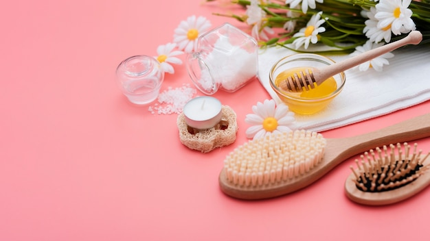 High angle of spa brushes and honey