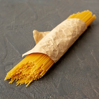High angle of spaghetti on plain background