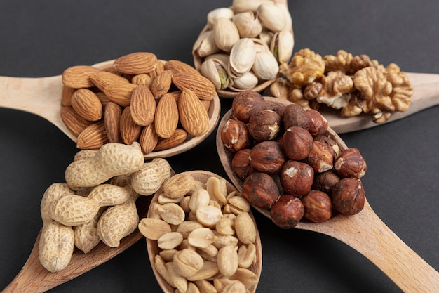 High angle of spoon with assortment of nuts