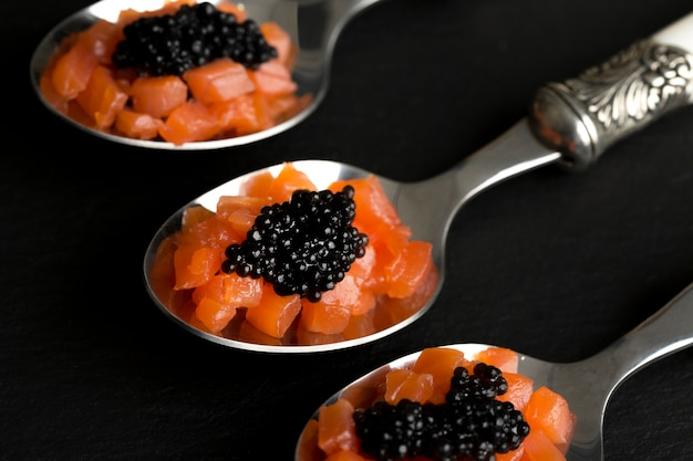 High angle spoons with black caviar