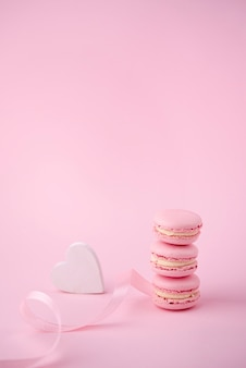 High angle of stack of macarons with heart and ribbon