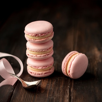 High angle of stack of macarons with ribbon