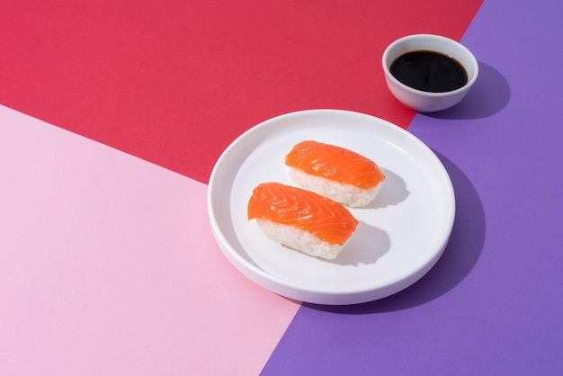 High angle sushi and soy sauce arrangement