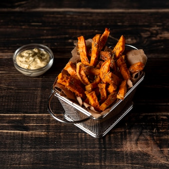 High angle sweet potato fries and sauce