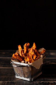 High angle sweet potato fries with copy-space
