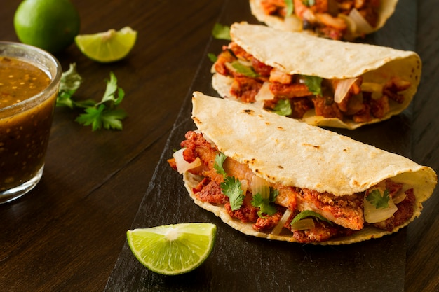 High angle tacos on wooden background