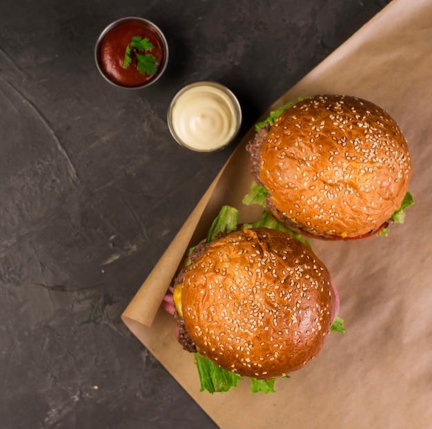 High angle tasty take away burgers with ketchup and mayo