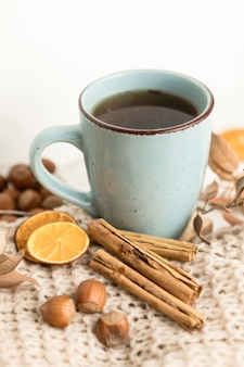 High angle of tea mug with chestnuts and cinnamon sticks