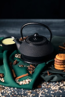 High angle tea time with snack on table